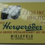 Altes Emailschild der Firma Hergeröder Bielefeld